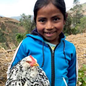 Esmeralda holding chicken